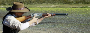 cowboy action shooting gal with rifle